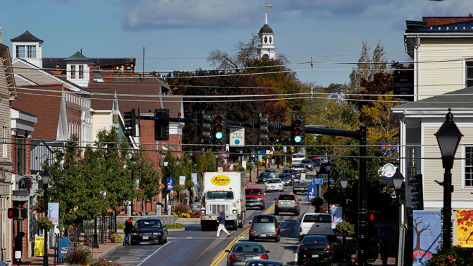 Oct. 12, 2012: A pedestrian crosses Route 1 in downtown Kennebunk, Maine.