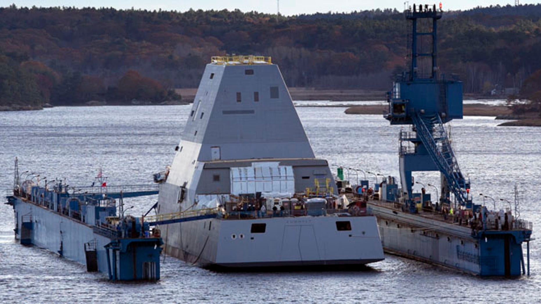 Oct. 28, 2013: The first-in-class Zumwalt, the largest U.S. Navy destroyer ever built, floats off a submerged dry dock in the Kennebec River, in Bath, Maine.