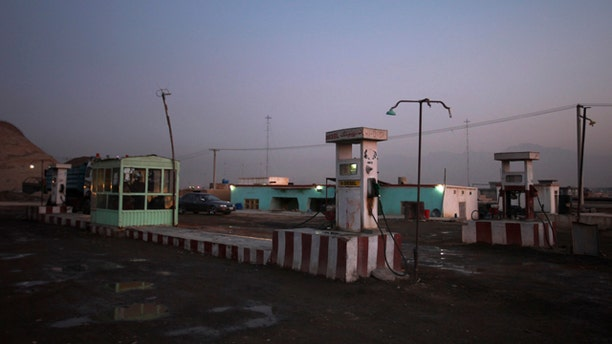 Jan. 4: A deserted fuel station is seen on the outskirts of Kabul, Afghanistan.