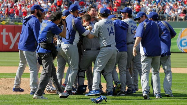 PHILADELPHIA - MAY 25: Starting pitcher Josh Beckett #61 of the Los Angeles Dodgers is swarmed by teammates after throwing a no hitter against the Philadelphia Phillies at Citizens Bank Park on May 25, 2014 in Philadelphia, Pennsylvania. The Dodgers won 6-0. (Photo by Hunter Martin/Getty Images)