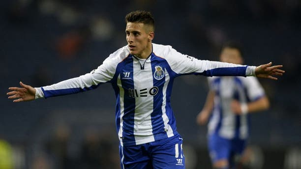 Porto's Spanish forward Cristian Tello celebrates with teammates after scoring a goal during the Portuguese league football match FC Porto v FC Pacos de Ferreira at the Dragao stadium in Porto on February 1, 2015. AFP PHOTO / MIGUEL RIOPA (Photo credit should read MIGUEL RIOPA/AFP/Getty Images)
