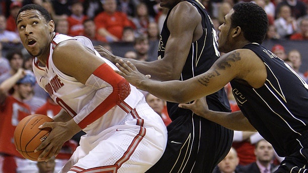 Jan. 25: Ohio State's Jared Sullinger, left, looks for an open shot against Purdue's JaJuan Johnson, center, and Terone Johnson during the second half of an NCAA college basketball game in Columbus, Ohio,
