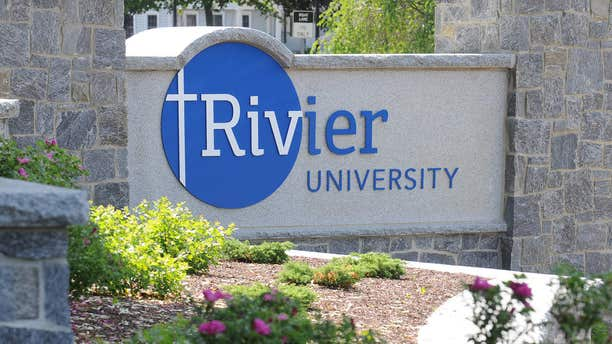 In this undated handout photo provided by Rivier University, the colleges' sign is seen at the entrance to the campus in Nashua, N.H.