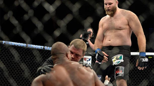 MASHANTUCKET, CT - SEPTEMBER 5: (R-L) Ben Rothwell dances over Alistair Overeem after defeating Overeem in their heavyweight weight fight during the UFC Fight Night event inside the Grand Theatre at Foxwoods Resort Casino on September 5, 2014 in Mashantucket, Connecticut. (Photo by Jeff Bottari/Zuffa LLC/Zuffa LLC via Getty Images) *** Local Caption ***Alistair Overeem;Ben Rothwell