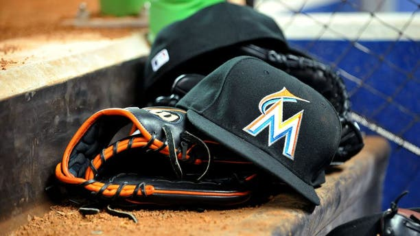 March 6, 2012; Miami, FL, USA; Miami Marlins baseball glove and hat are seen in the dugout during a spring training game against the Miami Hurricanes at Marlins Park. Mandatory Credit: Steve Mitchell-USA TODAY Sports
