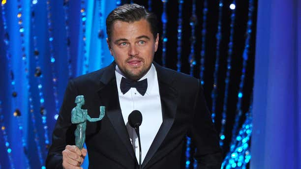 """Leonardo DiCaprio accepts the award for outstanding male actor in a leading role for """"The Revenant"""" at the 22nd annual Screen Actors Guild Awards at the Shrine Auditorium & Expo Hall on Saturday, Jan. 30, 2016, in Los Angeles."""