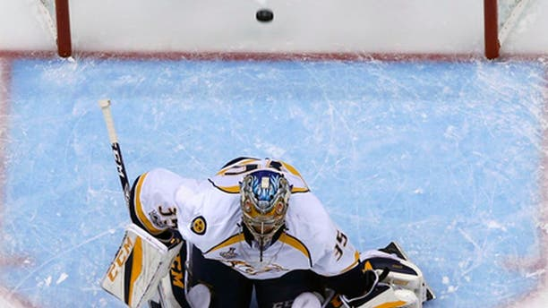 A shot by Pittsburgh Penguins' Justin Schultz gets past Nashville Predators goalie Pekka Rinne (35) for a goal during the first period of Game 5 of the NHL Stanley Cup Final, Thursday, June 8, 2017, in Pittsburgh. (AP Photo/Gene J. Puskar)