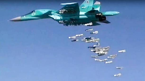 In this frame grab provided by Russian Defence Ministry press service shows a Russian combat fighter bomber Su-34 flies during an air strike over Syria on Thursday, Aug. 18, 2016. The Russian defense ministry said in a statement Friday it never targets populated areas and that rebels themselves hit urban areas in order to derail humanitarian efforts there. (Russian Defence Ministry Press Service photo via AP)