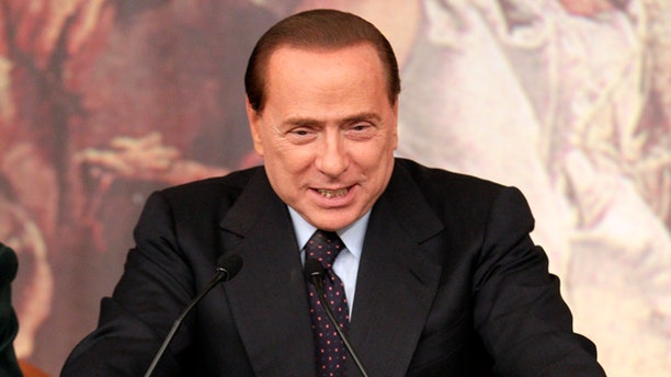 Feb. 9: Italian premier Silvio Berlusconi talks to journalists during a press conference following a cabinet meeting at Rome's Chigi palace.