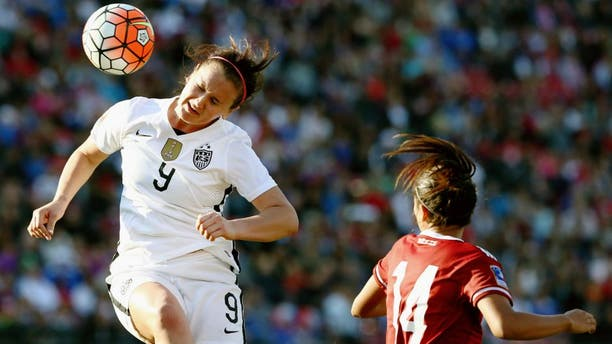 FRISCO, TX - FEBRUARY 13: Lindsey Horan #9 of USA heads the ball against Annia Mejia #14 of Mexico in the first half of the United States v Mexico: Group A - 2016 CONCACAF Women's Olympic Qualifying at Toyota Stadium on February 13, 2016 in Frisco, Texas. (Photo by Tom Pennington/Getty Images)