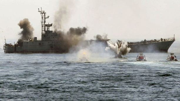 April 22, 2010: An Iranian warship and speed boats take part in a naval war game in the Persian Gulf and the Strait of Hormuz, southern Iran. (Reuters)