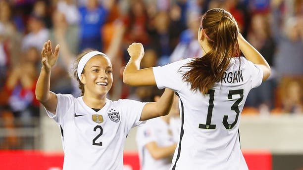 HOUSTON, TX - FEBRUARY 19: Mallory Pugh #2 and Alex Morgan #13 of the United States celebrate after Morgan scored a goal in the first half of their game against Trinidad and Tobago during their Semifinal of the 2016 CONCACAF Women's Olympic Qualifying at BBVA Compass Stadium on February 19, 2016 in Houston, Texas. (Photo by Scott Halleran/Getty Images)