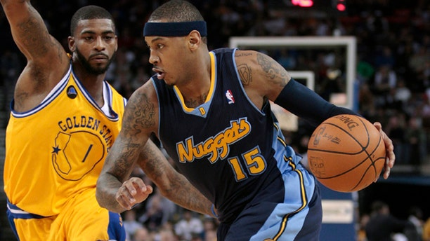 Feb. 9: Denver Nuggets forward Carmelo Anthony (15) drives against Golden State Warriors forward Dorell Wright (1) in the first quarter of an NBA basketball game in Oakland, Calif.