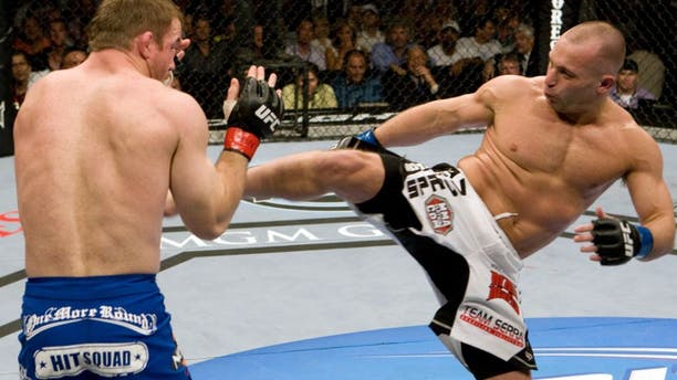 LAS VEGAS - MAY 23: Matt Hughes (blue shorts) def. Matt Serra (white shorts) - Unanimous Decision during UFC 98 at MGM Grand Arena on May 23, 2009 in Las Vegas, Nevada. (Photo by Josh Hedges/Zuffa LLC via Getty Images)