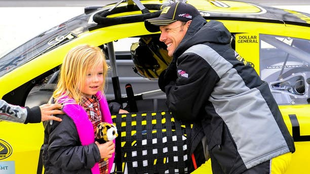 MARTINSVILLE, VA - MARCH 27: Matt Kenseth, driver of the #20 Dollar General Toyota, stands on the grid with his daughter, Grace, prior to qualifying the NASCAR Sprint Cup Series STP 500 at Martinsville Speedway on March 27, 2015 in Martinsville, Virginia. (Photo by Alex Goodlett/Getty Images)