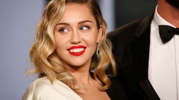 APRIL 2018: Miley Cyrus arrives at the 2018 Vanity Fair Oscar Party. She took to Twitter on Sunday to take back an apology over a 2008 Vanity Fair photo spread.