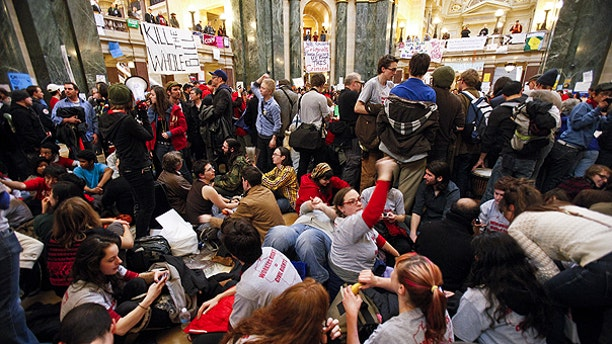 Feb. 27: Student Labor Action Coalition members demonstrate at the state Capitol in Madison, Wis., on the 13th day f protests over the governor's proposed budget.