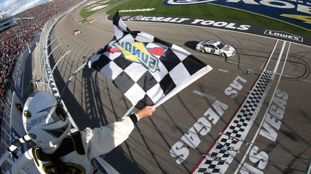 LAS VEGAS, NV - MARCH 06: Brad Keselowski, driver of the #2 Miller Lite Ford, crosses the finish line to win the NASCAR Sprint Cup Series Kobalt 400 at Las Vegas Motor Speedway on March 6, 2016 in Las Vegas, Nevada. (Photo by Sean Gardner/NASCAR via Getty Images)