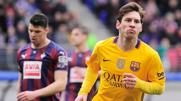 CORRECTION - Barcelona's Argentinian forward Lionel Messi (R) celebrates after scoring during the Spanish league football match SD Eibar vs FC Barcelona at the Ipurua stadium in Eibar on March 6, 2016. / AFP / ANDER GILLENEA / The erroneous mention[s] appearing in the metadata of this photo by ANDER GILLENEA has been modified in AFP systems in the following manner: [ADDING CODE FOR LIVE REPORT]. Please immediately remove the erroneous mention[s] from all your online services and delete it (them) from your servers. If you have been authorized by AFP to distribute it (them) to third parties, please ensure that the same actions are carried out by them. Failure to promptly comply with these instructions will entail liability on your part for any continued or post notification usage. Therefore we thank you very much for all your attention and prompt action. We are sorry for the inconvenience this notification may cause and remain at your disposal for any further information you may require. (Photo credit should read ANDER GILLENEA/AFP/Getty Images)
