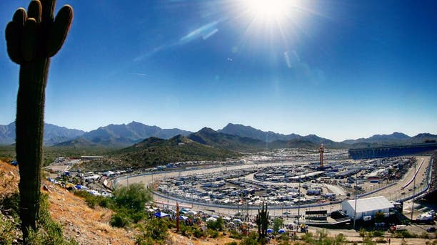 AVONDALE, AZ - NOVEMBER 09: (EDITOR'S NOTE: Image was processed using digital filters.) A general view of the speedway as cars race during the NASCAR Sprint Cup Series Quicken Loans Race for Heroes 500 at Phoenix International Raceway on November 9, 2014 in Avondale, Arizona. (Photo by Sean Gardner/NASCAR via Getty Images)