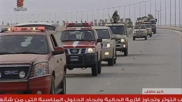 March 14: This screen grab taken from Bahrain TV shows troops arriving in Bahrain from Saudi Arabia.