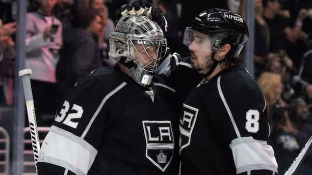 Mar 16, 2015; Los Angeles, CA, USA; Los Angeles Kings goalie Jonathan Quick (32) is congratulated by defenseman Drew Doughty (8) after the game against the Arizona Coyotes at Staples Center. The Kings defeated the Coyotes 1-0. Mandatory Credit: Kirby Lee-USA TODAY Sports