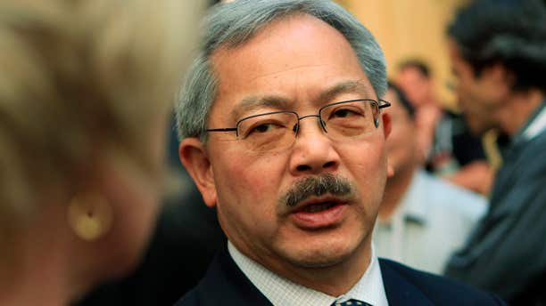 San Francisco Mayor Ed Lee speaks with attendees at the Web 2.0 Summit in San Francisco, California.