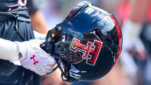 LUBBOCK, TX - OCTOBER 10: A Texas Tech Red Raider player holds a helmet before the game against the Iowa State Cyclones on October 10, 2015 at Jones AT&T Stadium in Lubbock, Texas. Texas Tech won the game 66-31. (Photo by John Weast/Getty Images)