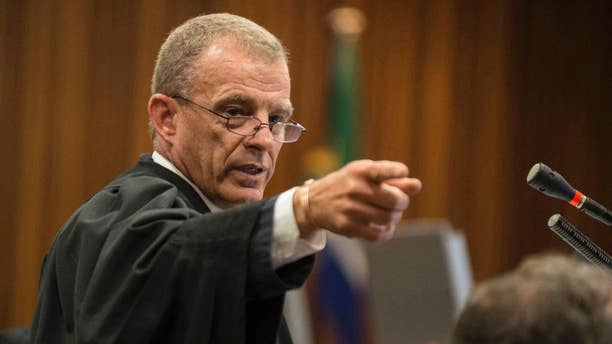 FILE -- In this Thursday, Aug. 7, 2014 file photo, state prosecutor Gerrie Nel gestures, during the Oscar Pistorius murder trial in Pretoria, South Africa. Nel announced Tuesday, Jan. 31, 2017 that he has quit his position and will head AfriForum's new private prosecuting unit, which will target state officials and politicians suspected of graft. (AP Photo/Mujahid Safodien, Pool, File)