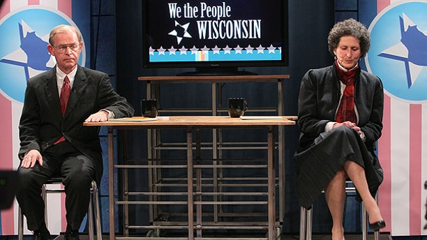 FILE: This March 25, 2011, photo shows Justice David Prosser, left, and Asst. Attorney General JoAnne Kloppenburg, before a debate at Wisconsin Public Television studio in Madison, Wis.