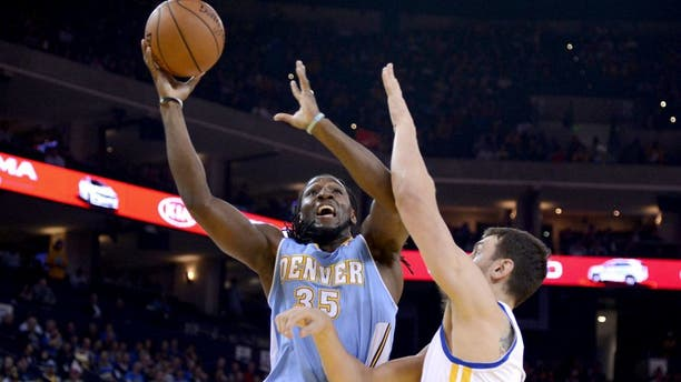 April 10, 2014; Oakland, CA, USA; Denver Nuggets forward Kenneth Faried (35) shoots the ball against Golden State Warriors center Andrew Bogut (12) during the first quarter at Oracle Arena. Mandatory Credit: Kyle Terada-USA TODAY Sports