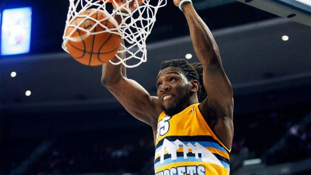 Apr 2, 2014; Denver, CO, USA; Denver Nuggets forward Kenneth Faried (35) dunks the ball during the second half against the New Orleans Pelicans at Pepsi Center. The Nuggets won 137-107. Mandatory Credit: Chris Humphreys-USA TODAY Sports