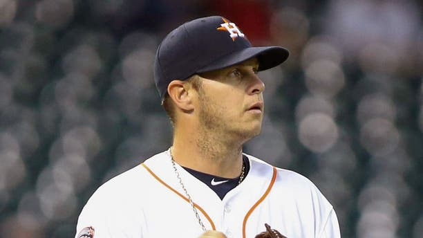 Apr 14, 2015; Houston, TX, USA; Houston Astros starting pitcher Brad Peacock (41) reacts after a play during the second inning against the Oakland Athletics at Minute Maid Park. Mandatory Credit: Troy Taormina-USA TODAY Sports