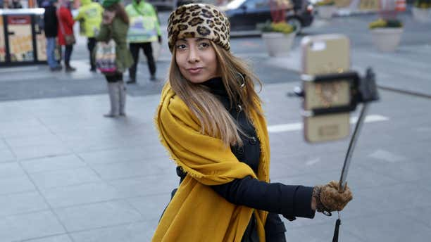 Jan. 8, 2015: Sandy Johal uses a selfie stick to take a picture of herself in New York's Times Square.