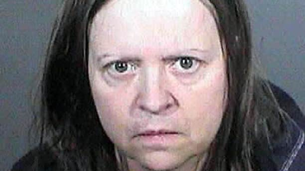 This undated law enforcement booking photo from the Los Angeles County Sheriff's Office shows Cathryn Parker.