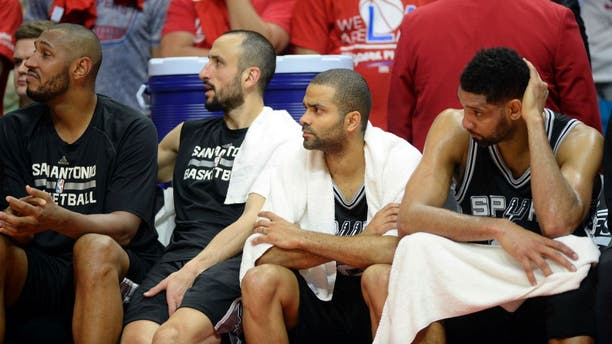 Apr 19, 2015; Los Angeles, CA, USA; San Antonio Spurs center Boris Diaw (33), guard Tony Parker (9), guard Manu Ginobili (20), guard Tony Parker (9) and forward Tim Duncan (21) during the fourth quarter against the Los Angeles Clippers in game one of the first round of the NBA Playoffs at Staples Center. Mandatory Credit: Richard Mackson-USA TODAY Sports
