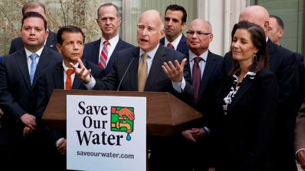 April 28, 2015: Gov. Jerry Brown talks during a news conference after meeting with several California mayors to discuss water conservation at the Capitol in Sacramento, Calif.