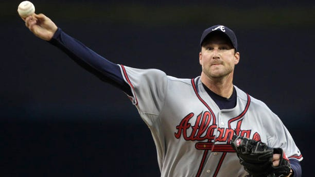 April 25: Atlanta Braves starting pitcher Derek Lowe releases a pitch against the San Diego Padres in the first inning of a baseball game in San Diego.