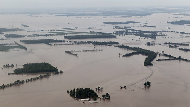 May 3: Part of the 130,000 acres of farmland flooded by an intentional break in the Birds Point levee is seen in Mississippi Country, Mo.