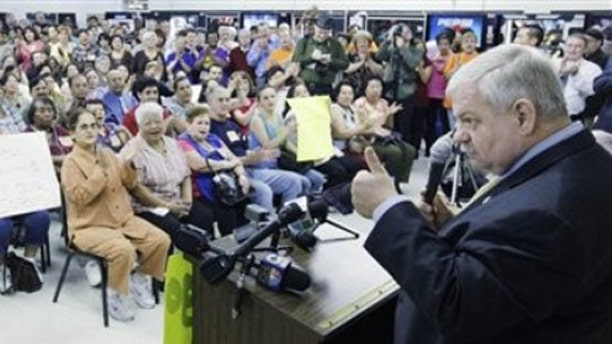 In this May 11, 2009 photo, U.S. Rep. Phil Hare, D-Ill. , addresses workers at a Hartmarx Corp. plant in Des Plaines, Ill. (AP)