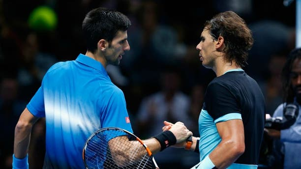 during the Barclays ATP World Tour Finals on Day Seven at O2 Arena on November 21, 2015 in London, England.,LONDON, ENGLAND - NOVEMBER 21: Novak Djokovic of Serbia is congratulated by Rafael Nadal of Spain in the semi final during the Barclays ATP World Tour Finals on Day Seven at O2 Arena on November 21, 2015 in London, England. (Photo by Julian Finney/Getty Images)