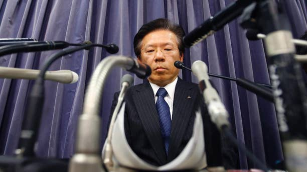 FILE - In this April 26, 2016, file photo, Mitsubishi Motors Corp. President Tetsuro Aikawa listens to a reporter's question during a press conference in Tokyo. The Japanese automaker said Friday, June 17, 2016, it will take a 50 billion yen ($913 million) charge to cover mileage-rigging expenses, including for the eK minicar models sold in Japan since 2013, and also under the Nissan label, as well as 30,000 yen ($290) compensation each for some other Mitsubishi models. (AP Photo/Shizuo Kambayashi, File)