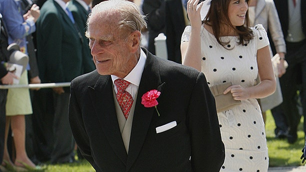 June 4: Britain's Prince Philip, the Duke of Edinburgh, left, and Princess Eugenie arrive on Derby Day at Epsom Downs Racecourse in Epsom, England.