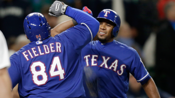 Texas Rangers' Prince Fielder celebrates with Elvis Andrus, right, after Ardus hit a solo home run on a pitch from Seattle Mariners' Steve Cishek to tie a baseball game in the ninth inning Saturday, June 11, 2016, in Seattle. (AP Photo/John Froschauer)