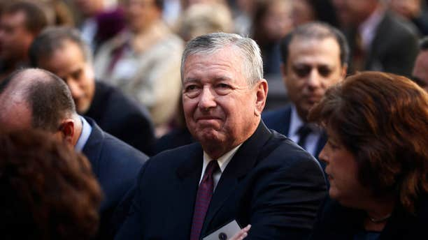 FILE -- In this Oct. 28, 2013 file photo, former U.S. Attorney General under President George W. Bush, John Ashcroft, attends the installation ceremony of James Comey as FBI director, in Washington.