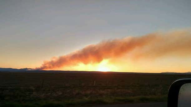 Photo shows wildfire burning in New Mexico in Manzano Mountains