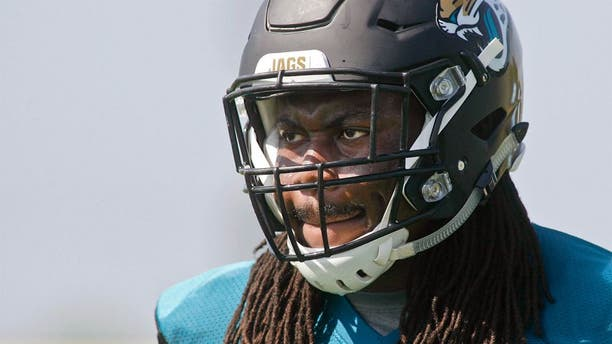 Jun 16, 2015; Jacksonville, FL, USA; Jacksonville Jaguars guard A.J. Cann (60) during minicamp at the Florida Blue Health and Wellness Practice Fields. Mandatory Credit: Phil Sears-USA TODAY Sports