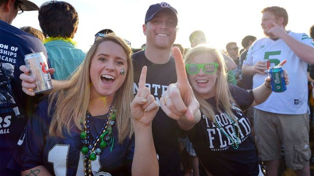 Jan 7, 2013; Miami, FL, USA; Notre Dame Fighting Irish fans Eileen Veihmeyer (left), Patrick Veihmeyer (center), and Abigail Chappell pose for a photo before the 2013 BCS Championship game against the Alabama Crimson Tide at Sun Life Stadium. Mandatory Credit: Steve Mitchell-USA TODAY Sports