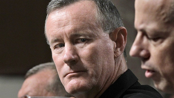 June 28: Navy Vice Adm. William H. McRaven, center, nominee to become commander of the U.S. Special Operations Command, listens to testimony by Marine Lt. Gen. John Allen, right, nominee to become commander of U.S. forces in Afghanistan, during a confirmation hearing on Capitol Hill in Washington.