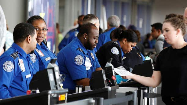 May 27, 2016: Transportation Security Administration (TSA) agents check-in passengers at JFK airport in the Queens borough of New York.